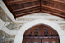 The west portico's new ceiling of vertical-grain Douglas fir; the original carving above the doors was refinished.<br/>Photograph: Caitlin Cunningham